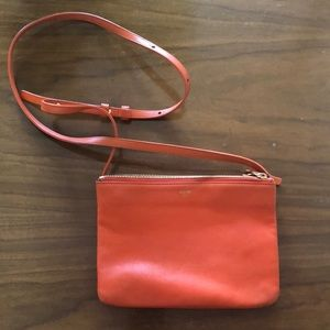Celine small orange trio bag